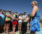 KAS628 Martha Gaskill (cq), an above the knee amputee, talks to the swimmers at the end of...