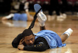 (Minneapolis,CO - Shot on 4/19/04)  The Denver Nuggets' Marcus Caamby stretches out during...