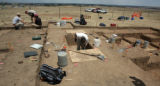 Workers excavate Native American artifacts in Douglas County south of Lincoln Ave. and east of...