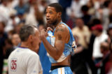 (Minneapolis,CO - Shot on 4/19/04)  The Denver Nuggets' Marcus Camby (#23) walks off the court...