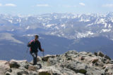 With the front range in the background, Chris Tomchuck (cq), of Breckenridge, approaches the top...