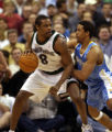 (Minneapolis,CO - Shot on 4/21/04)  The Denver Nuggets' 24Andre Miller guards the Minnesota...