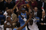 (Minneapolis,CO - Shot on 4/21/04)  The Denver Nuggets' Carmelo Anthony surrounded by   the...