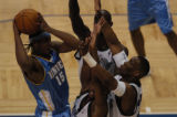 (Minneapolis,CO - Shot on 4/21/04)  The Denver Nuggets' Carmello Anthony surrounded by T wolves in...