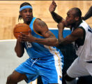 (Minneapolis,CO - Shot on 4/21/04)  The Denver Nuggets' Carmelo Anthony (#15) looks to pass as the...