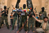 AKCF109 - Palestinian militants from the Popular Resistance Committee, one of the groups holding...