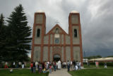 Parishoners gather outside at Our Lady of Guadalupe Parish Church, Colorado's oldest, after mass...