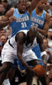 (Minneapolis,CO - Shot on 4/18/04)  The Denver Nuggets' Nene (#31) and Marcus Camby (#23) close in...