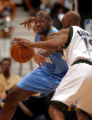 (Minneapolis,CO - Shot on 4/18/04)  The Denver Nuggets' Nene (#31) tries to steal the ball from...