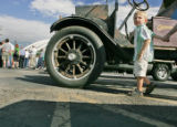 Liam Clevenger (cq), 4, of Denver holds his grandmother's hand as he checks out a 1919 Oldsmobile...