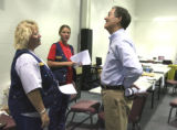 L ro T: Forest Service employees  Mavis Biastoch (cq) and Patty Wyatt (cq) talk to Gov. Bill Owens...