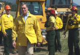 Gov. Bill Owens walks leaves after talking  to ground crew members fighting the fire just  north...