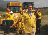 Gov. Bill Owens  walks away after talking  to ground crew members fighting the fire just  north...