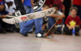 Skateboarders watch on as a pair of skaters go head-to-head in a Game of Skate, a bracket-stlye...