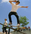 Luke Contreras (cq, center), 16, of Denver ollies onto a rail in the Denver Skatepark as Phil...