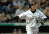 (DENVER, CO., APRIL 20, 2004)  Colorado Rockie outfielder, #35, Jeromy Burnitz tosses his bat as...