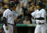 (DENVER, CO., APRIL 20, 2004)  Colorado Rockies third baseman, #9, Vinny Castilla, right, is...