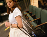 KAS148 Juliet Villa waits to go on stage with her seeing-eye dog, Deidra, during rehearsal of the...