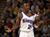 Sacramento Kings guard Bobby Jackson tries to get the sympathy of a ref by saying his jersey was...