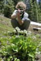 Aron Ralston(cq) photographs flowers along Collins Creek near Vegneur Mountain during an 18 mile...