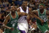 Boston Celtics Michael Stewart (5)and Mark Blount (30) jossle Sacramento Kings Jabari Smith late...