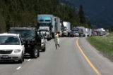 A driver looks west on I-70 near Georgetown to see when traffic might be moving again, June 12,...