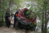 Denver fireman check out a car that ended up in the South Platte  River, it was part of an...