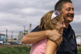 Brooke Shelton (cq) gets a hug from Denver fireman Kurt Salley (cq) at an accident at Alameda and...