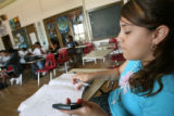 (Foreground) Pricilla Guzman (CQ), 15, of Denver works on a class assignment during summer school...