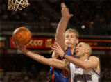 Kings point guard Mike Bibby is fouled by New York Knicks center Michael Doleac during the third...