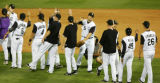 Matt Holliday slaps hands with the rest of the team after beating the San Francisco Giants at...