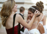 (Denver, Colo., June 17, 2006) Emily Sullivan, left, straightens the tiara for Malia Myers.  Le...