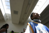 Devante Roberts, 12 (cq) looks up through some sky lights at Del Pueblo Elementary School.  He and...