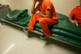 Inmates sit on overflow matresess at the Arapahoe County Detention Facility as Arapahoe County...