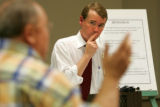 Denver Public Schools Superintendent Michael Bennet listens to a question from Barry Bley, CQ, a...