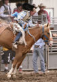 KAS270 Andrew Harris of Elbert competes in the championship round of saddle bronc riding at the...