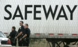 police stand guard outside of a Safeway warehouse as police try to clear the building after a...