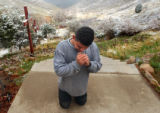 (Golden, Colo., April 22, 2004) Carlos Rodriguez, 27, of Denver, prays midway up the stairs to the...