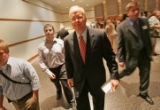 Karl Rove, assistant deputy chief of staff and senior advisor to President George W. Bush, leaves...