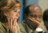 04/23/2004 Broomfield, Colo.-Independent Investigative Commission Chairman Lawrence, left, listens...
