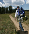Chef Sean Yontz (Cq), with Chama restaurant, poses with a backpack in Evergreen, Colorado, on June...