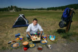 Chef Sean Yontz (Cq) with some ingredients he recommends adding to dehydrated camping food.  He...