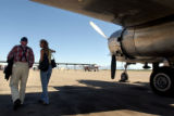 04/14/2004 Tucson, Arizona-Bill Bower, 87, Boulder, walks under the wing of a B-25 bomber with his...