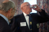 04/16/2004 Tucson, Arizona-Doolittle Raider Bill Bower finishes a goblet of brandy after toasting...