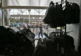 A traveler walks past the Airport Baggage Center in the main terminal at DIA Tuesday morning July...