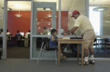 (LAKEWOOD, Colo., May 4, 2004) Jesus Torres plays an improvised game of chess with his dad, Omar...