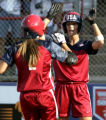 OKSO108 - United States' Caitlin Lowe, right, greets teammate Jessica Mendoza after Mendoza's...
