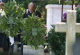 John Ramsey takes a moment alone at St. James Episcopal Cemetery in Marietta, GA  on June 29,...