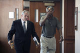 L to R: James O'Connor, public defender for Anthony Law, walks with Melvin Law (father of Anthony...