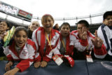 Athletes from Team New Mexico cheer during the opening ceremonies of the North American Indigenous...